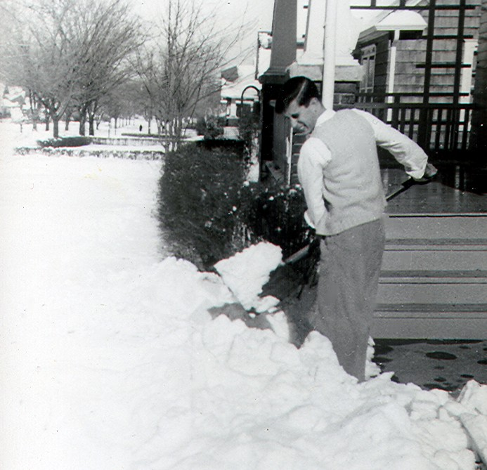 1950s man shoveling snow