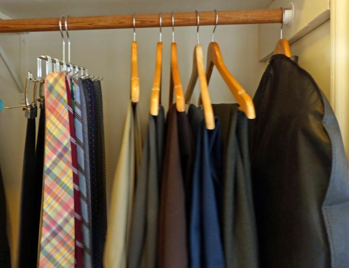 Dress pants on hangars.  Ties.