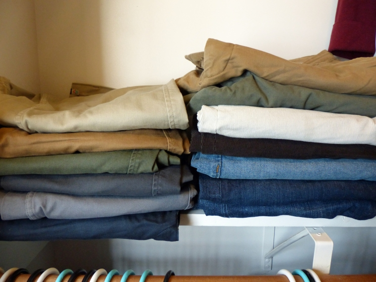 Pants organized by color.